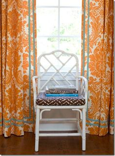 White Chinese Chippendale chair {Ballard Designs} and orange & white damask pattern drapes with turquoise trim. Fab! By designer Palmer Weiss.