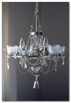 eye-catching chandeliers are made from recycled kitchen and dining items.