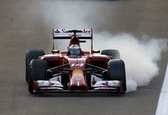 Ferrari's Spanish driver Fernando Alonso breaks hard after the start of the of the Abu Dhabi Formula One Grand Prix at the Yas Marina circuit on November 23, 2014