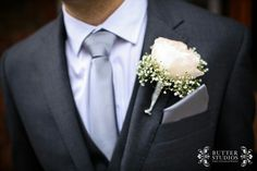 Groom's boutonniere. Soft pink rose with baby's breath. Blush and gray weeding.