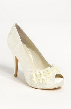 I loved my wedding shoes, but where were these when I was shopping for them????  Menbur Floral Lace Pump available at Nordstrom
