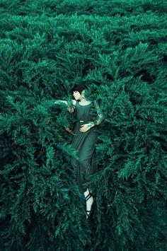 green girl in dress lying