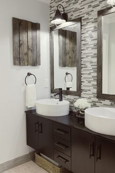 Master Bathroom.  I like the vanities, sink, fixtures, and mirrors, but I am so beyond sick of the tacky glass tile.