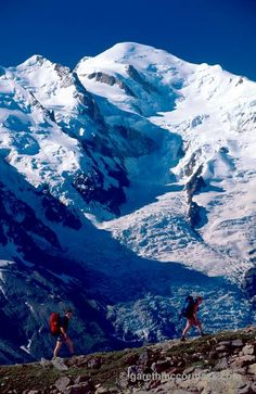 Walkers on the Balcon Sud beneath Mt Blanc, Chamonix Valley, French Alps, France. Stock Photo