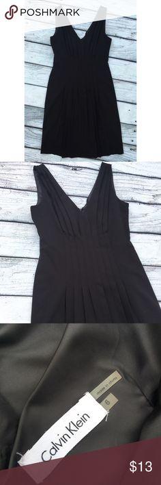 Calvin Klein black business dress size 6 Preowned black sleeveless Calvin Klein knee length dress Pleated in the front back zipper back has slit size 6 Calvin Klein Dresses