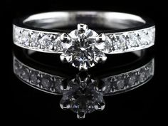 18K White Gold And Diamond Engagement Ring,  .88Ct Total Diamond WeightOne Round Ideal Hearts And Arrows Cut Diamond Weighing .55Ct With A Clarity Gra...