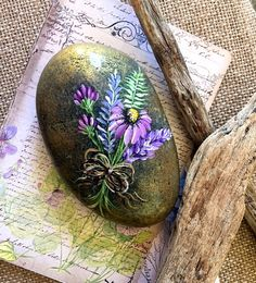 Painted Rock, Purple and Lavender Rock, Garden Rock, Paperweight, Hand Painted Rock, Painted Bouquet A Smooth Southern California Beach Rock is canvas for a charming hand painted Bouquet of Lavender, Purple and Lilac shades of Wildflowers. Please tap +MORE to see full description