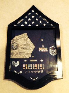 Solid wood USAF Master Sergeant Stripe Shadow Box Painted black. $250. If interested, contact Tom at Jenkswood@gmail.com