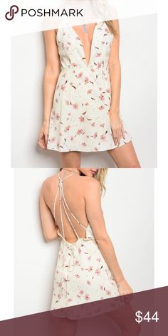 New strappy back floral dress Made in the USA Fabric Content: 100% POLYESTER Dresses Mini