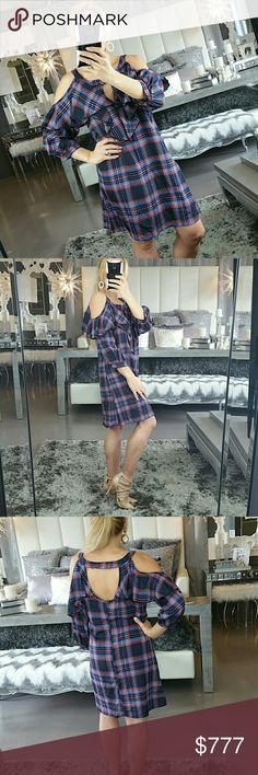 """Plaid print cold shoulder dress NWOT Brand new no tags  Playful plaid print dress featuring complimentary colors, sassy cold shoulder detail & sexy peekaboo  front with ruffles. This is perfect for any season! For cooler weather pair with boots and a denim jacket or for warmer weather heels and a floppy hat!!   Medium Bust 18.5""""Length 33.5"""" Large  Bust 20"""" Length 33.5""""   💖Shop with confidence💖💖 🎉🎊Suggested User🎊🎉 📮💌Same day shipping📮💌 5🌟🌟🌟🌟🌟 star rated closet Dresses"""