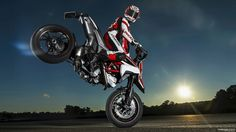 MotoGP racer, Nicky Hayden does strange and wonderful things with the new Hypermotard 1100 SP Ducati Multistrada 1200, Ducati Hypermotard, Flat Track Motorcycle, Motorcycle News, New Ducati, Nicky Hayden, Ducati Motorcycles, Street Bikes, Sport Bikes