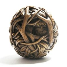 Susan Wraight: Midnight, 2013. Netsuke, hand-carved & stained boxwood, inlaid amber and gold leaf. Height 4.5cm Diameter 5cm - owl