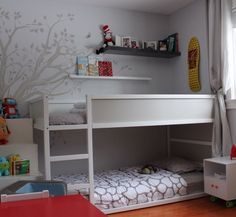 White-gray IKEA Kura for a neutral kids room-wall mural