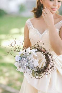 This bride chose to incorporate a nest of branches into her bouquet.