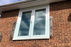 Simple Juliette balcony on a modern property with double doors Glass Balcony, Small Balcony Decor, Loft Conversion Juliet Balcony, Juliette Balcony, Modern Properties, Laminated Glass, Apartment Balconies, Architectural Features, Double Doors