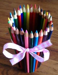 Cute Idea! I am going to use scrapbook paper to cover the can instead of pencils and I will make one for each type of art materials my daughter has for her craft corner