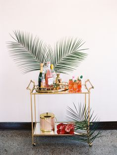 """With a vision of """"a glamorous garden party with the nostalgia of Palm Springs,"""" this all-star team of creatives dreamt up this tropical bridal shower editorial we want to dive right into. Palm leaves and pineapples, bright colors and signature cocktails — this shoot"""
