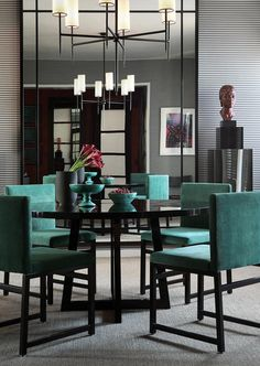 Rich turquoise velour sets an elegant mood in this round dining ensemble
