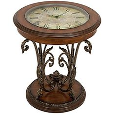 This unique metal and wood end table features a working clock underneath the tempered-glass top.