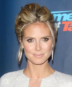 Heidi Klum Hairstyle - Casual Updo. Try on this hairstyle. http://www.thehairstyler.com/hairstyles/casual/updo-long/straight/heidi-klum