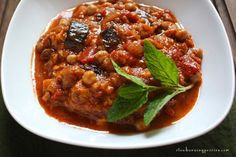 Maghmour is Lebanon's take on Moussaka. Roasted eggplant, tomatoes, chickpeas, olive oil, and mint. It's amazingly delicious stuff.