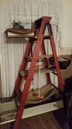 Cat tower made with a wooden ladder.