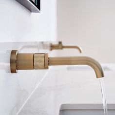 Collection: Litze • Finish: Brilliance Lux Gold • Product: Wall Mount Lavatory Faucet • Space designed by: Studio Zung