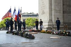 Airmen from the 86th Airlift Wing and United States Forces in Europe – Air Forces Africa, Ramstein Air Base, Germany, participate in a Memorial Day ceremony at the Arc de Triomphe in Paris, France, May 24, 2015, to pay respects to the Tomb of the Unknown Soldier on Memorial Day weekend. The Unknown French Soldier died during WWI and is buried beneath the Arc de Triomphe. While his identity is still unknown, he is daily remembered with wreaths and an eternal flame. (U.S. Air Force photo by…