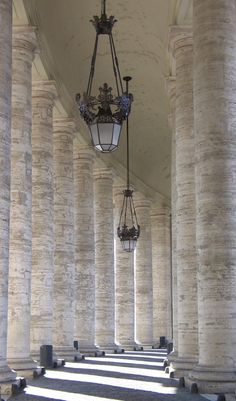 Curving pillars of luminous light, St Peter's, Rome.