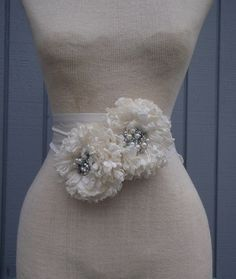 A personal favorite from my Etsy shop https://www.etsy.com/listing/88326859/off-white-color-wedding-belt-wedding
