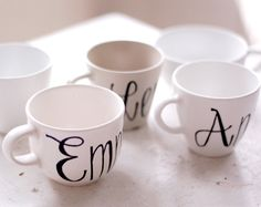 dollar store tea cups, sharpie markers to personalize names. bake in the oven at 350˚ for 30 minutes!