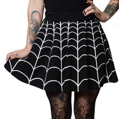 You'll cast a web of intrigue wearing this Kreepsville 666 web skater skirt! Flared skirt with wide elastic waistband and back zip. - 95% cotton, 5% spandex with discharge print. Made in the USA