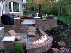 backyard patio, patio chairs, umbrella, gas firepit, Back Yards, Patio, Stairs, Fire Pits / Fireplaces, Curves, Posts, Walls & Courtyard