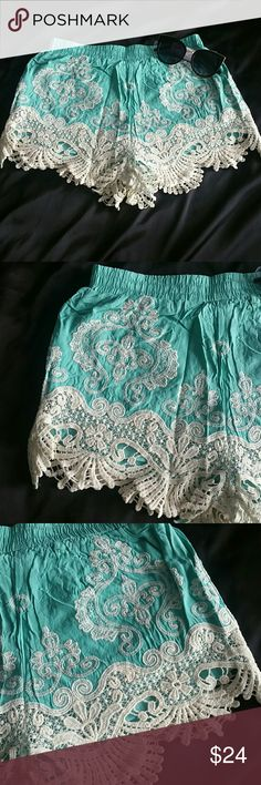 Only 2 left! Too cute turquoise crochet shorts! Adorable shorts! Pretty turquoise color! Girly crochet detail! Comfy fabric! Stretchy waistband! Perfect short for summer! Happy Shopping! Fashionomics Shorts
