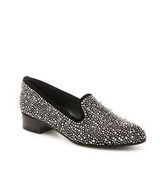 "SLIPBEADS | Stuart Weitzman  Menswear inspired smoking slipper for the lady who enjoys her sparkle!      Menswear inspired smoking slipper adorned with metal studs and suede trim        Slip on      1¾"" heel      Leather footbed      Made in Spain"