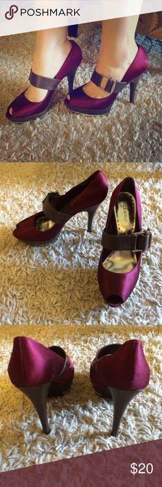 Burgundy heel with brown strap Burgundy buckled heels peep toe. Has minor wear, but still in good condition. BCBG Shoes Heels