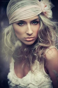 messy waves and thick head scarf.