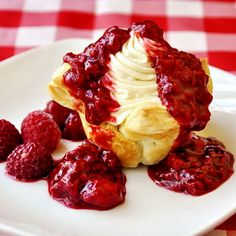 Easy Raspberry and White Chocolate Tarts - still another red and white dessert for Canada Day! Tart shells made from frozen puff pastry filled with an easy white chocolate whipped cream and drowned in sweet raspberry compote.