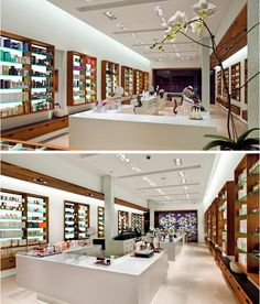 PLUMM APOTHECARY MANHASSET NY located in a Long Island high-end retail mall, combines the cool, clean atmosphere of a laboratory with the warm, luxe materials of a lounge. The recessed ceiling slots fitted with multiple sources address this complexity and provide accent lighting for display shelves & counters as well as task lighting for patrons. All architectural surfaces are lit via concealed fixtures so as not to interfere with the planes & textures of materials.
