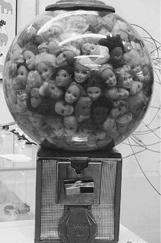 Barbie Head Gumball Machine. I can hear them all screaming as they suffocate - this would drive me mad.