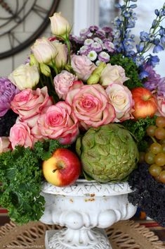 Flower arrangement with fruit and veggies | ©homeiswheretheboatis.net #tablescapes #flowers