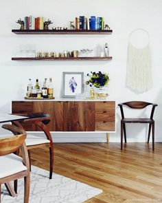 love these wooden floating shelves with the console