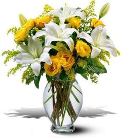 white Asiatic lilies yellow spray roses and solidago accented with seeded eucalyptus and pittosporum.