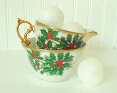 This festive Holly Sprigged Tea Creamer and Sugar Set was originally released by Ucagco at the same time as their December Flower of the Month Tea