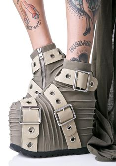 "Current Mood Milly Platforms are for the post apocalyptic warrior princesses. Slay 'em all with these epic platforms, featurin' a badazz textured canvas exterior with exXxaggerated ridges, exposed seams, three sik metal buckles with grommets wrapping around ya and an interior ankle exposed zipper closure. Complete with an xtra soft vegan leather interior with a cushioned insole, staggering 5"" platform wedges and textured tread."