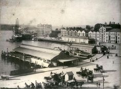 1890 - Circular Quay, Sydney. Check out the original ferry terminals to Manly and Watsons Bay and the horse-drawn carts as they grace the harbour foreshore to what is now the home to one of Sydney's most iconic buildings, The Opera House.