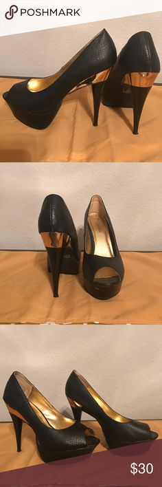 Iliana Size 8.5 Black and Gold Platform Pump When you want to flash a little metal on your shoes these get the job done. The Gold accent makes this more than your ordinary black shoe. Worn a couple of times. Very good condition. Liliana Shoes Platforms