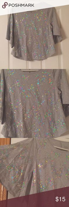 Justice Girls SS Sequined Top - 16 Justice girls short sleeved gray sequined top. Very loose and flowing feel. Sequence pick up light and color and make it very perfect for the holiday season. Gently used/loved, worn only once. Size 16. Justice Shirts & Tops Tees - Short Sleeve