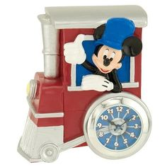 Disney Mickey Mouse Analog Mini Clock by M.Z. Berger. $24.99. A mini clock featuringMickey and his trainProductInformationThe Disney Mickey Mouse Analog Mini Clock is a pact fun way to keepthe time and show your love for Disney and for the Mouse himself.Mickey stars as conductor of a train in this mini clock andthe large wheel holds the clock which blends right into thedesign.The Disney Mickey Mouse Analog Mini Clock has a smallsize that's great for use on a desk nightsta...