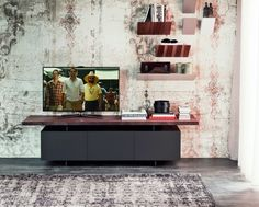 Stunning multi-purpose TV cabinet or low sideboard with 3 or 4 wooden doors painted in matt graphite or matt white. The top is presented in the same colour as the frame or in solid Canaletto walnut, burned oak or natural oak and comes with natural irregular edges. Striking and functional.